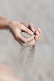 Песок в руках Стоковое Изображение