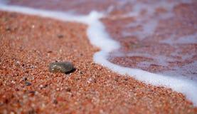 Песок и волны макроса Стоковая Фотография
