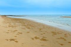 Песок и море пляжа Стоковые Изображения