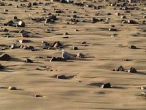 Песок и пляж камешков Стоковое Изображение