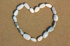 песок камушков сердца Стоковая Фотография