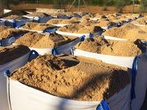 Песок конструкции в сумках стоковое изображение