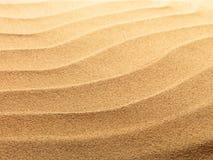 песок пляжа предпосылки Стоковые Изображения RF