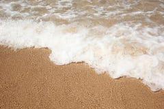Песок пляжа и морская вода Стоковое фото RF