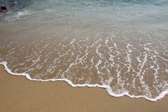 Песок пляжа и морская вода Стоковое Фото