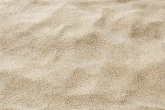 Песок пляжа моря для текстуры и предпосылки Стоковая Фотография