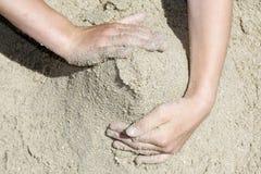 песок рук Стоковые Фото