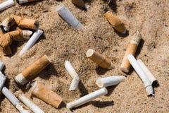 песок сигареты приклада стоковые фотографии rf