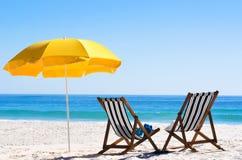 песок стулов пляжа Стоковые Изображения RF