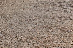 Песок с картинами следа воды стоковые изображения