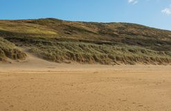 Песок Woolacombe около Barnstaple, Девона, Англии Стоковое фото RF