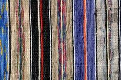 Пестрая текстура текстильных тканей половика Стоковая Фотография