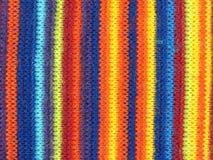 Пестротканая предпосылка ткани вертикальной нашивки Стоковое фото RF
