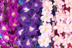 Пестротканые искусственные орхидеи как предпосылка Стоковые Фотографии RF
