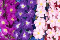 Пестротканые искусственные орхидеи как предпосылка Стоковое Изображение