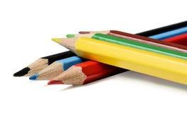 Пестротканые карандаши на белой изолированной предпосылке Взгляд со стороны стоковое фото