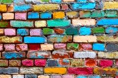 Пестротканые кирпичи старой стены дома Стоковое Изображение