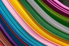 Пестротканые листы бумаги в пакете абстрактная предпосылка цветастая Стоковая Фотография