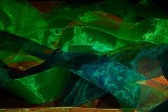 Пестротканые просвечивающие ленты разбрасываемые случайно Стоковые Изображения RF