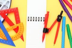 Пестротканые ручка, правители и тетрадь Стоковые Изображения