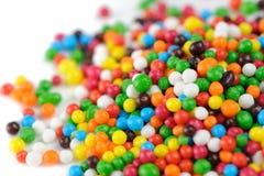 Пестротканый сахар брызгает (конец-Вверх съестных украшений пирожного) Стоковая Фотография
