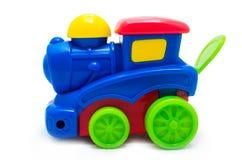 Пестротканый яркий пластичный локомотив пара игрушки Стоковое фото RF