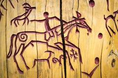 Петроглифы на дереве Стоковое Изображение