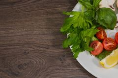 Петрушка, лимон, перец, champignons на плите Стоковые Фото