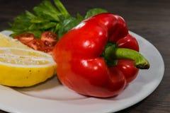 Петрушка, лимон, перец, champignons на плите Стоковое Изображение RF