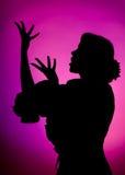 петь силуэта Стоковая Фотография