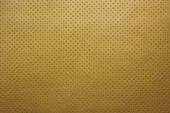 Пефорированная желтым цветом кожаная предпосылка текстуры Стоковая Фотография RF