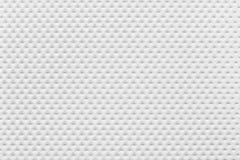 Пефорированная картина бумаги покрывает белый цвет Стоковая Фотография