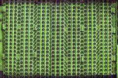 Пефорированный зеленым цветом строб металла стоковое изображение rf