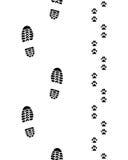 Печати ботинок и лапок Стоковая Фотография RF