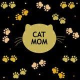 Печати кота и лапки черные и золотая покрашенная белая предпосылка Будьте матерью поздравительной открытки текста мамы кота `` дн Стоковое фото RF