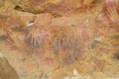Печати руки на стене пещеры Стоковые Изображения RF