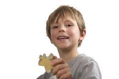 печенье мальчика его показ Стоковое Фото