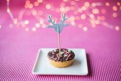 Печенье рождества на розовой предпосылке Стоковые Фото