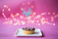 Печенье рождества на розовой предпосылке Стоковые Изображения