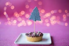 Печенье рождества на розовой предпосылке Стоковая Фотография