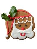 Печенье Санта на красной и белой предпосылке Стоковые Фото