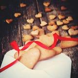 Печенья в форме сердца от письма тонизировано Стоковая Фотография
