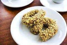 2 печенья гайки на белизне Стоковая Фотография