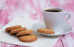 Печенья и чашка кофе Стоковые Изображения