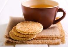 Печенья и чашка чаю кокоса Стоковое Изображение RF