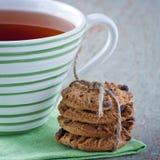 Печенья и чашка чаю Стоковые Фотографии RF