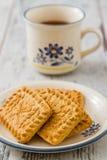 Печенья и чашка чаю Стоковое Фото