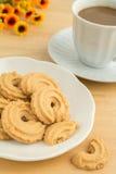 Печенья масла и кофейная чашка стоковое изображение