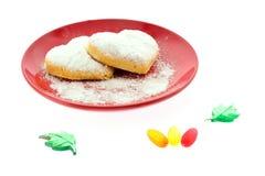 Печенья на красном поддоннике Стоковая Фотография