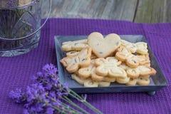 Печенья печениь масла бабочек и печенья сердца с Lave Стоковое фото RF